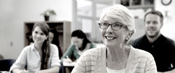 Happy senior woman at an adult education