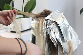 Young woman is getting her balayage, blo