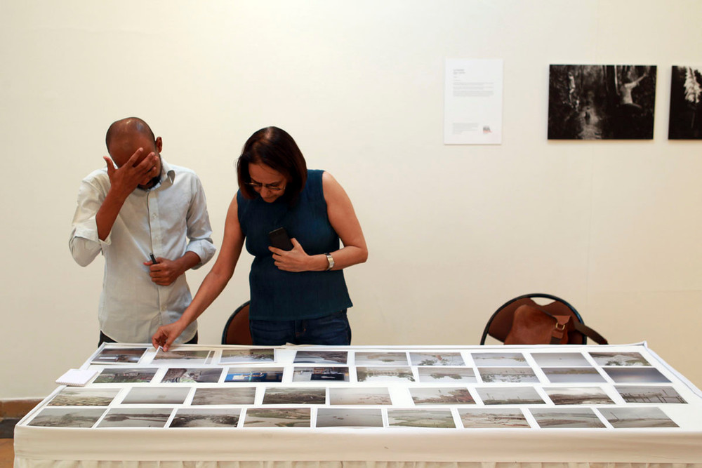 Ketaki Sheth reviews the work of a photographer during the professional portfolio review sessions