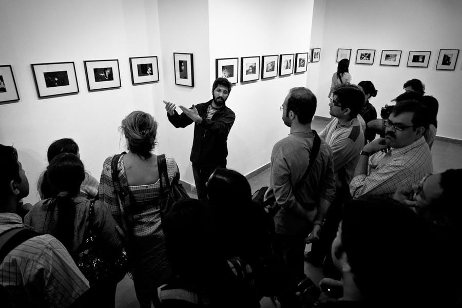 "Zishaan Akbar Latif's talks about his exhibition ""Solitary Splendour"" during a gallery walk"