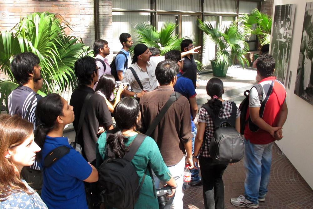 Nitin Rai leads a gallery walk through exhibits at the festival