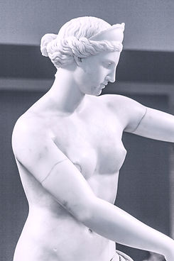 white-ceramic-statue-of-a-woman-3713493.