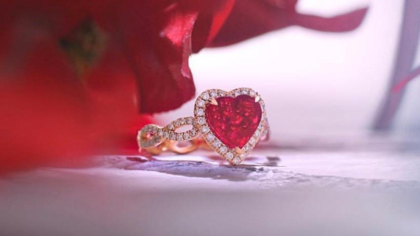 Heart shaped ruby diamond halo ring