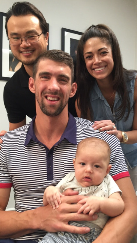 Nicole and Michael Phelps are longtime friends of INTA Gems & Diamonds! Nicole was the first Miss California USA to wear the Legacy crown designed by Peter Young. We love this photo of Nicole, Michael, their son Boomer, and Peter.