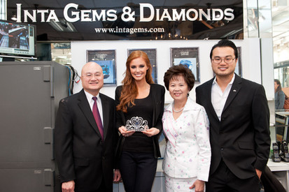 Jerry, Connie, and Peter Young pose with Miss USA 2011, Alyssa Campanella, and the Miss California USA Legacy Crown.