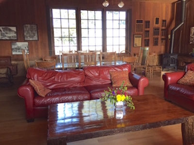Members Lounge with couches coffee and dining table