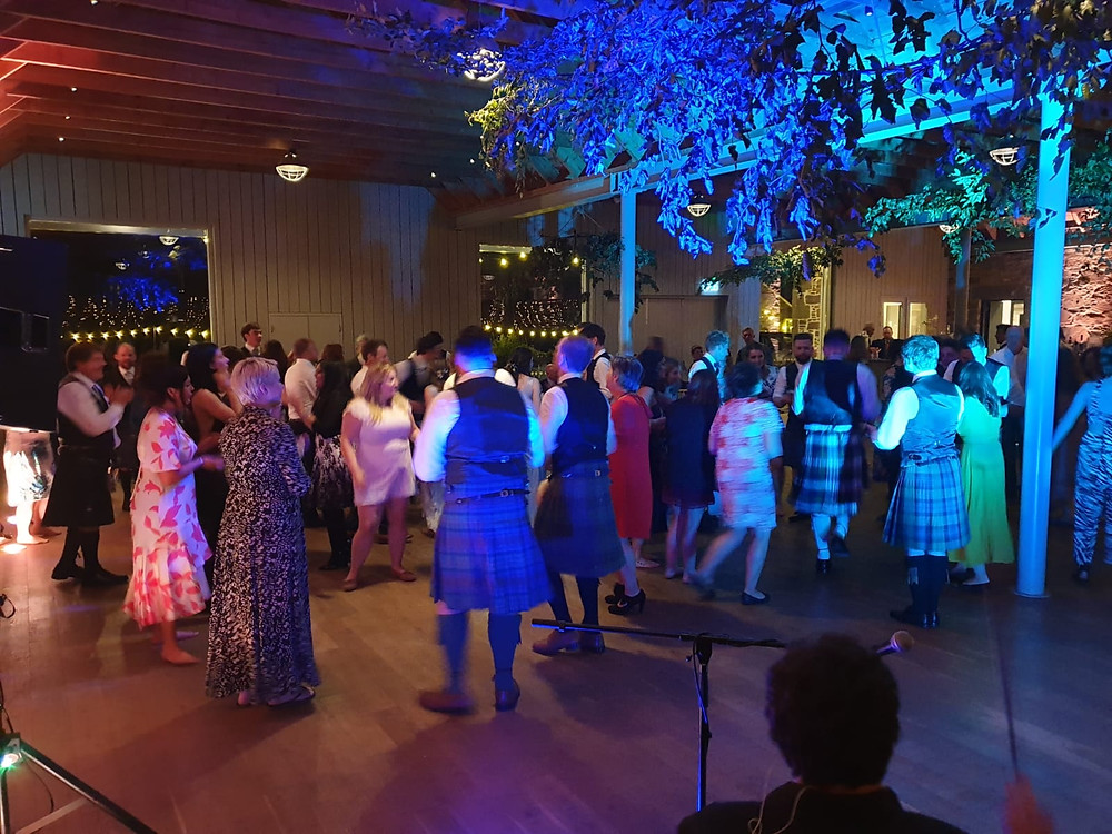 Katie & Harris' crowd ceilidh'ing at Guardswell Farm