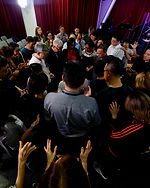 PEOPLE PRAYING TOGETHER IN COVENANT VISION