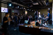 PEOPLE WORSHIPPING GOD IN THE AUDITORIUM OF COVENANT VISION