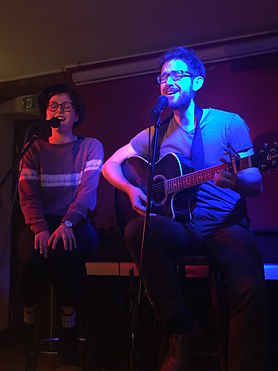 Two people at an open mic night