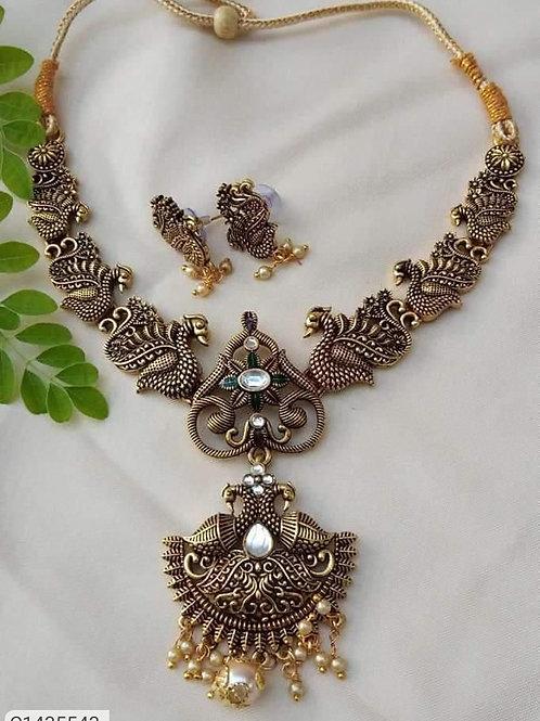 Beauteous Oxidized Gold Stone Jewellery Set