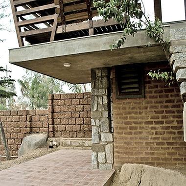Vernacular architectur, stabilized soil bricks, stone construction, wooden bench, farm house, green building