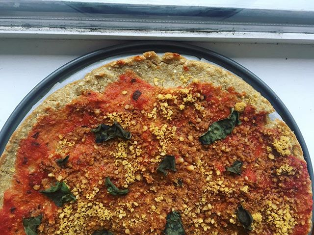 Quinoa crust pizza with nutritional yeast cheese and basil!