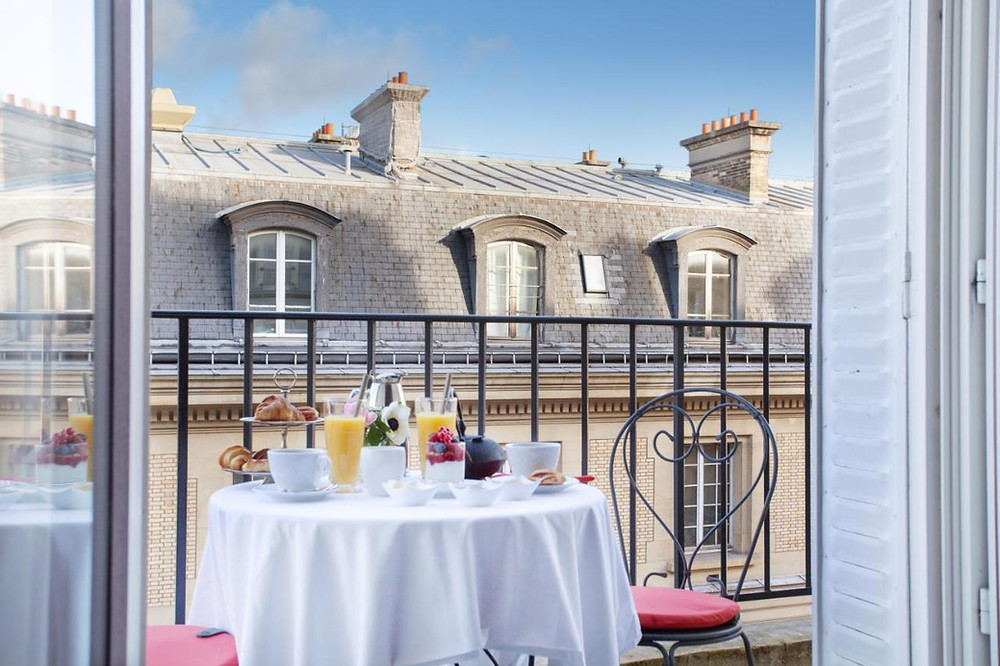 Breakfast set up on a balcony at the eco-friendly hotel Trianon Rive Gauche