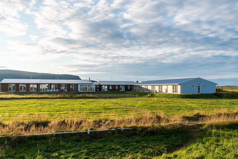 The exterior of Hotel Eldhestar, a green and sustainable hotel in South Iceland