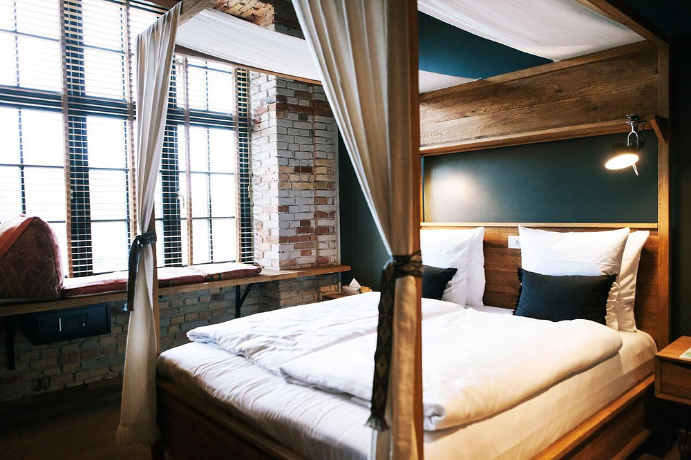 A bedroom at Bryggen Guldsmeden green hotel in Copenhagen.