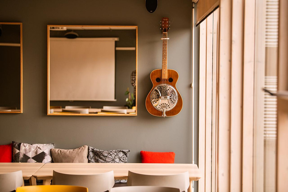 A guitar hangs on the wall at Reykjavik City Hostel, an environmentally friendly option to stay in Reykjavik outside the city centre