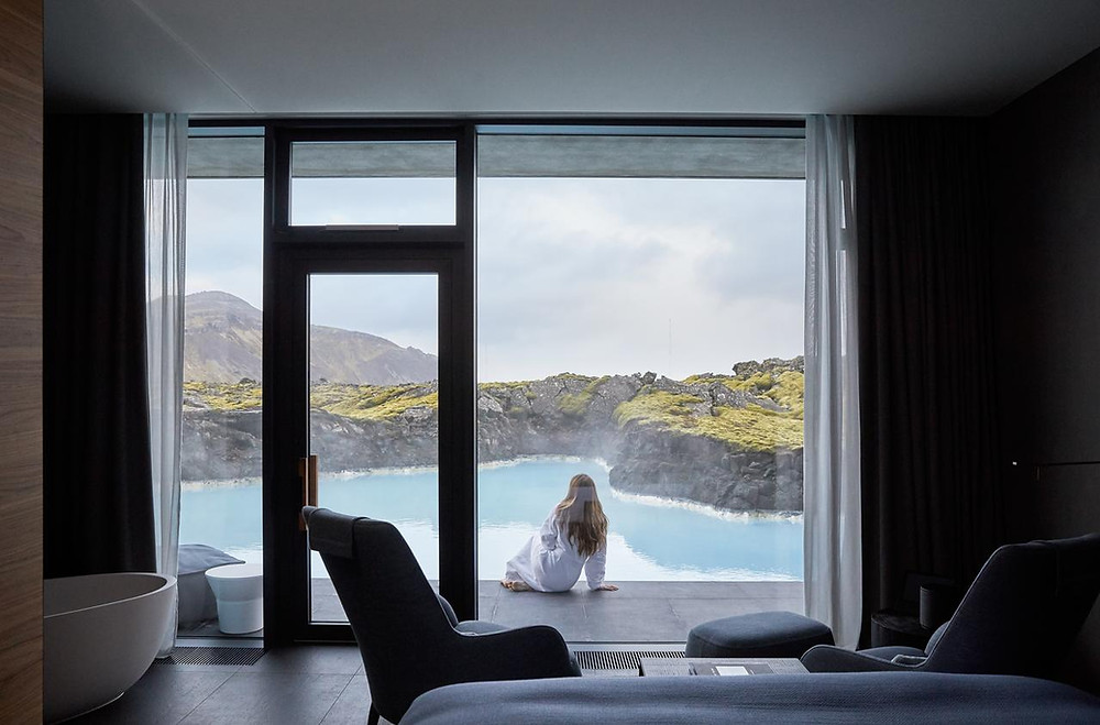 A girl sitting outside her room at The Retreat, the Blue Lagoon's low-impact and luxurious spa hotel