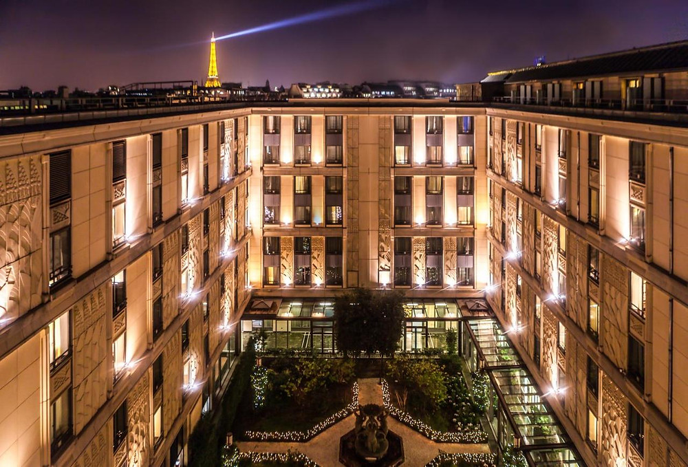A night time shot of Hotel du Collectionneur Arc de Triomphe, an eco-friendly hotel in Paris