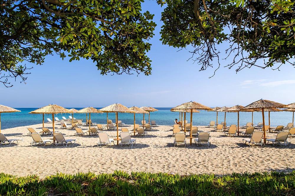 The beach at eco-friendly resort Kassandra Palace Hotel & Spa.