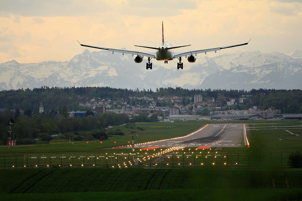 An eco-friendly airline plane landing at an airport runway