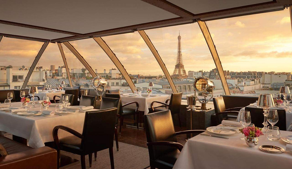 A view of the Eiffel Tower from the restaurant of the eco-friendly hotel The Peninsula Paris