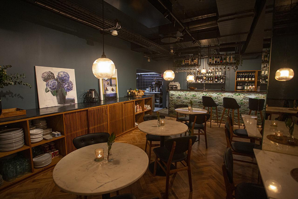 A cosy and inviting bar of the eco-friendly Von Guldsmeden hotel in Reykjavik, Iceland