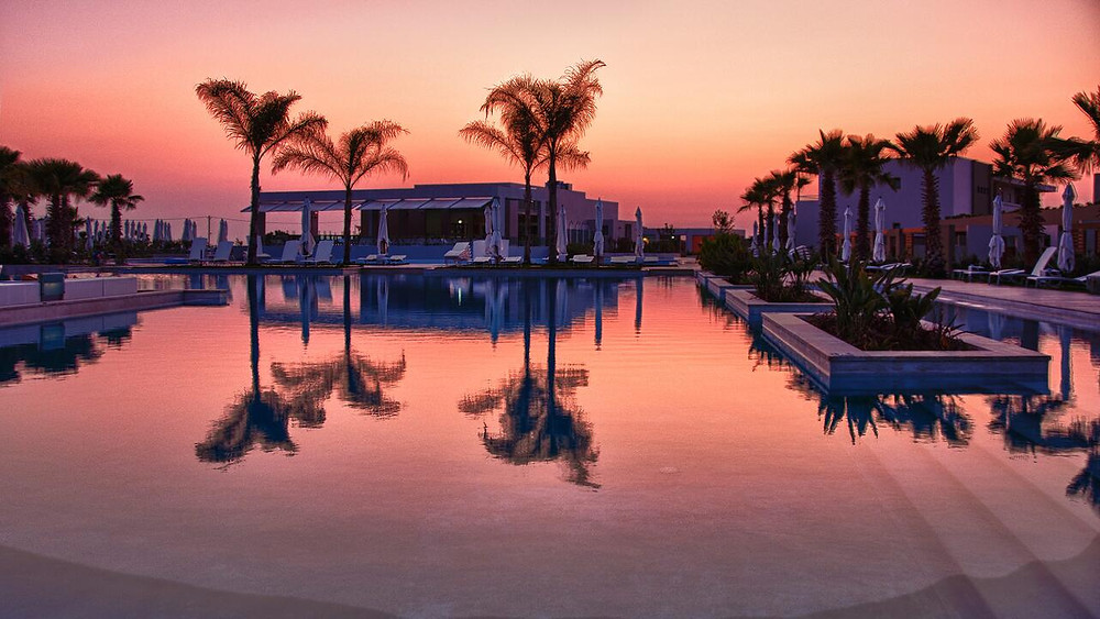 A fiery sunset at the Avra Imperial Hotel, a green hotel on Crete, Greece.