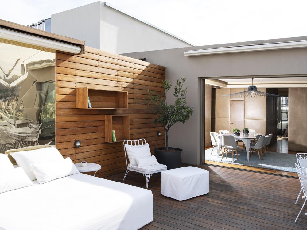 A terrace and hotel room at the eco-friendly New Hotel in Athens.