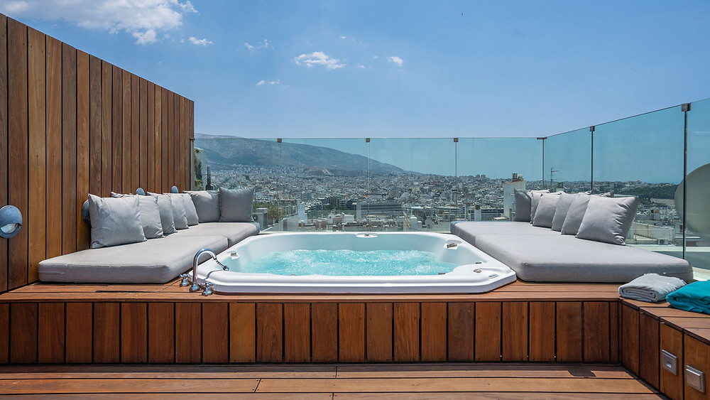 A rooftop hot tub at the Periscope Hotel, an eco-friendly hotel in Greece