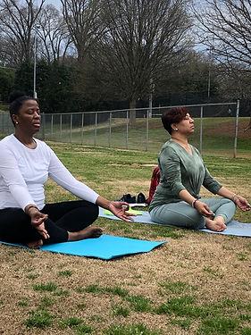yoga-in-the-park-black-women-meditating-