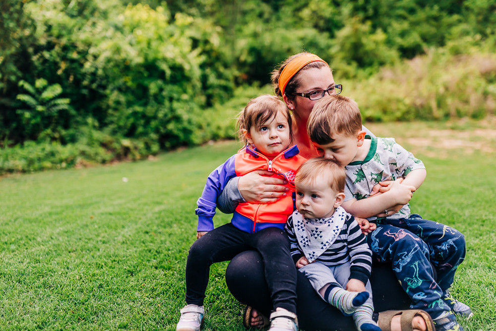 Mother and her children sitting in their backyard captured by knoxville family photographer sweetest moments photography