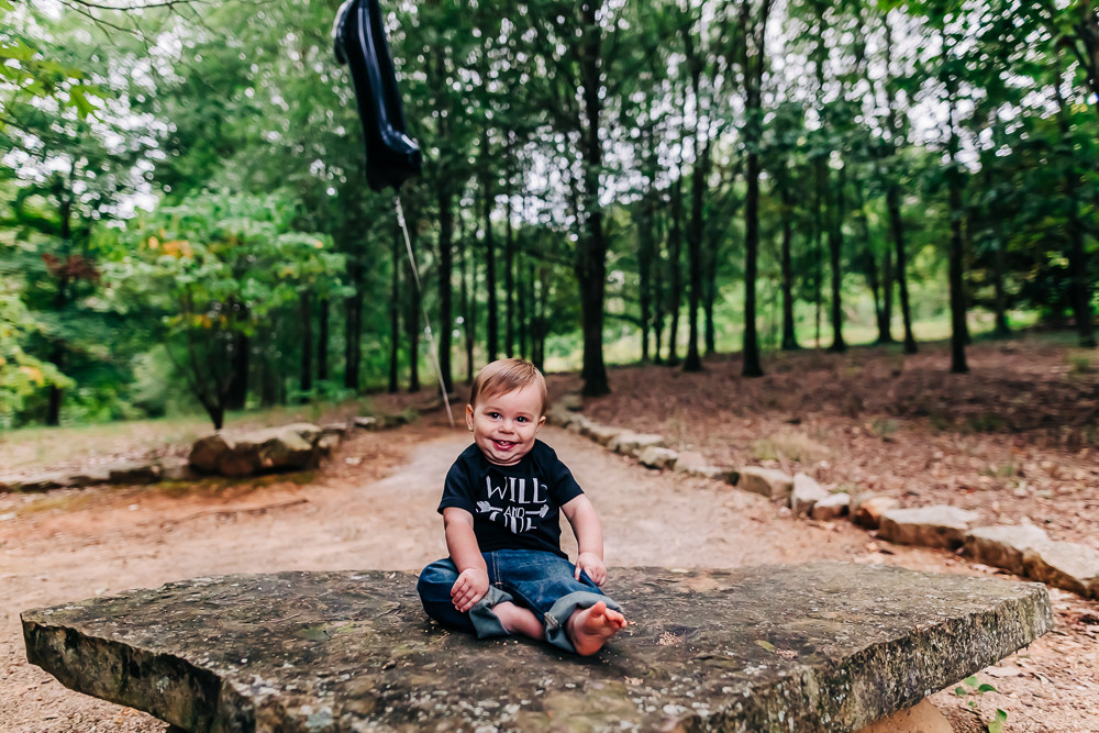 One year old little boy at the knoxville botanical gardens for his one year milestone photography session with sweetest moments photography in knoxville tn