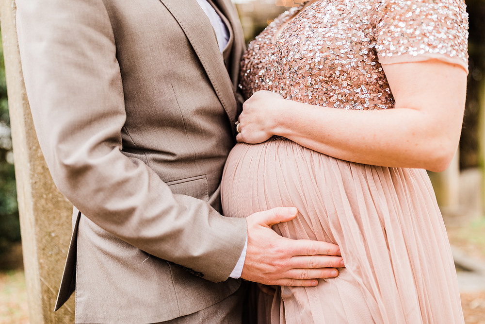 Glamorous mom to be having her maternity pictures taken at the bleak house in knoxville tn with sweetest moments photography