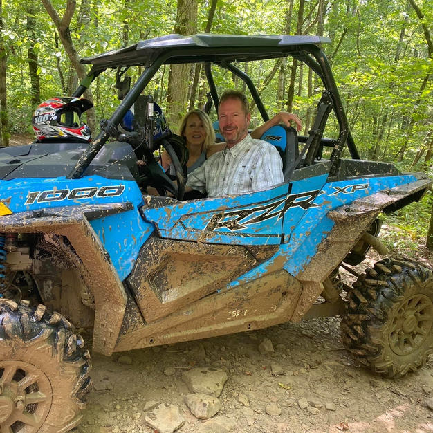 Dr. Dave and his wife on an ATV adventure