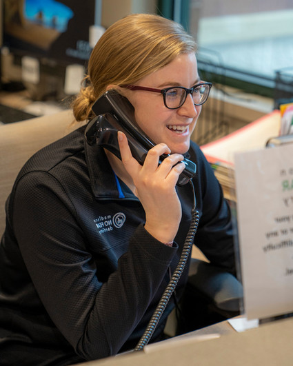 Kristi, a front desk coordinator at Madison No Fear Dentistry, talks to a patient on the phone.