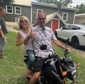 Dr. Dave and his wife on a motorcycle
