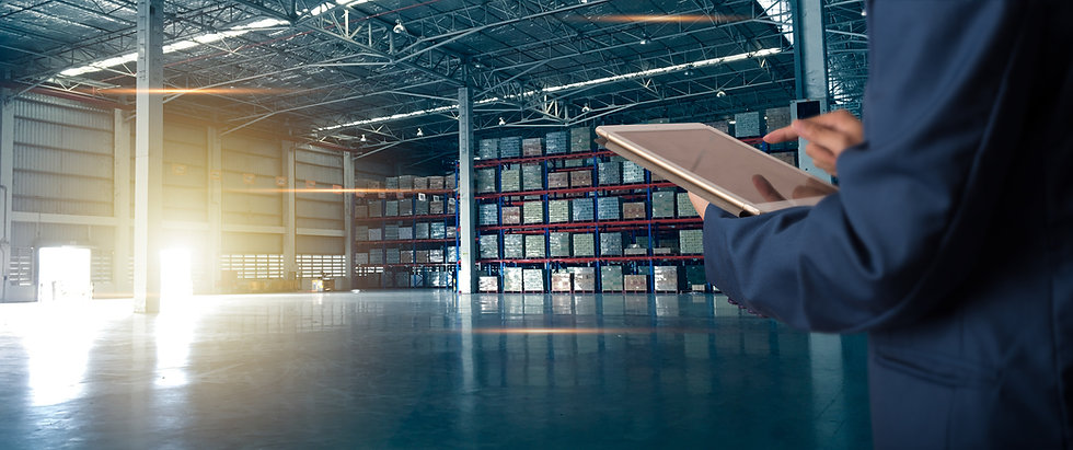 Businessman manager using tablet check and control for workers with Modern Trade warehouse