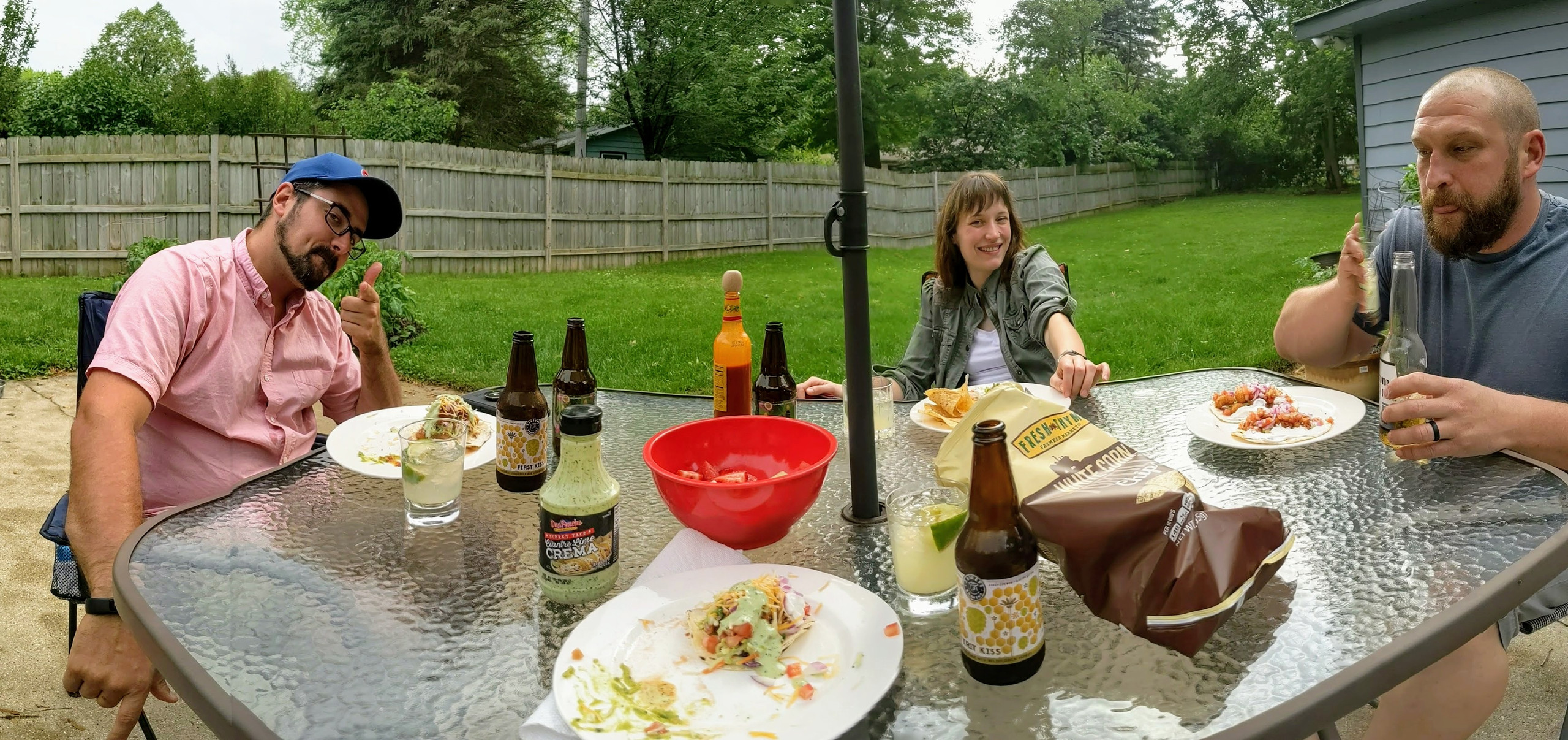 Panorama of friends eating tacos