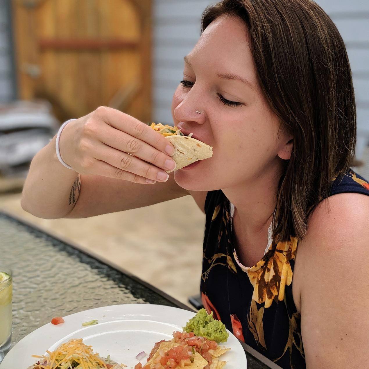 Me eating a shrimp taco