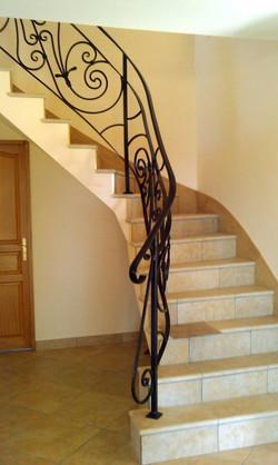 Rampe d'escalier avec volutes