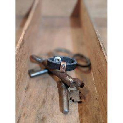 Recycled leather ring with charm