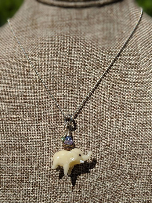 Glass elephant pendant necklace