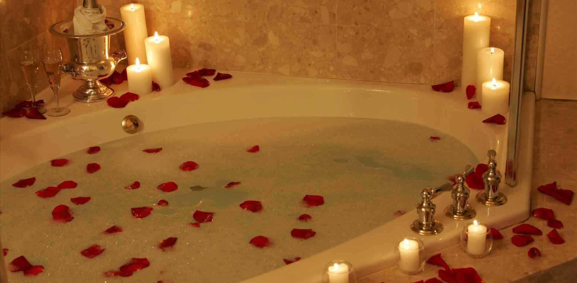 decorative-bed-with-flowers-and-candles-