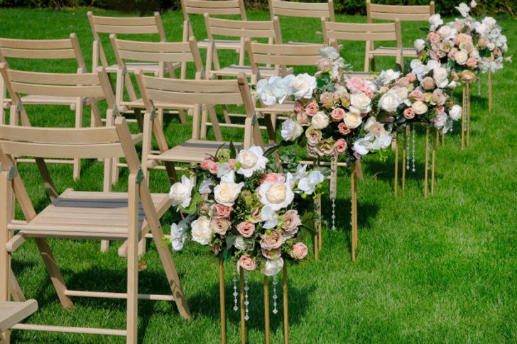 white-wooden-empty-chairs-row-flowers-bo