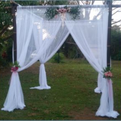 Four Post Bamboo Arbour with draping/flowers