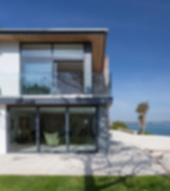 Glazed Balustrading to Terrace with Large Glazed Sliding Doors Providing Sea Views Across Torbay