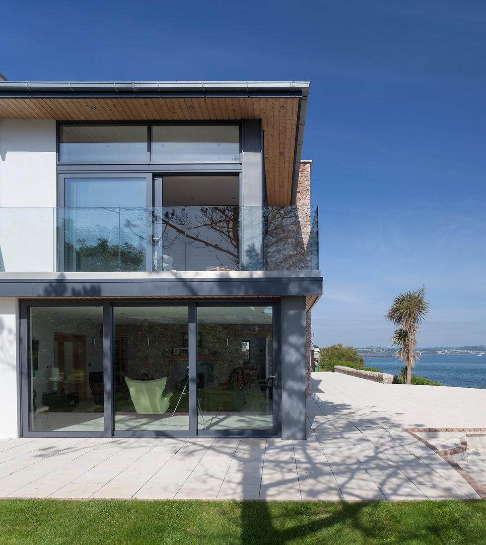 Glazed Balustrading to Terrace with Large Glazed Sliding Doors Providing Sea Views Across Torbay
