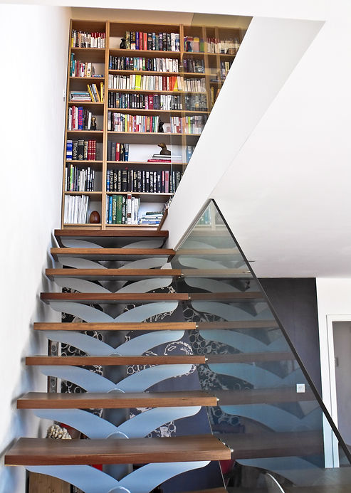 Bespoke Modern Staircase featuring glass balustrading, metal fins and timber treads