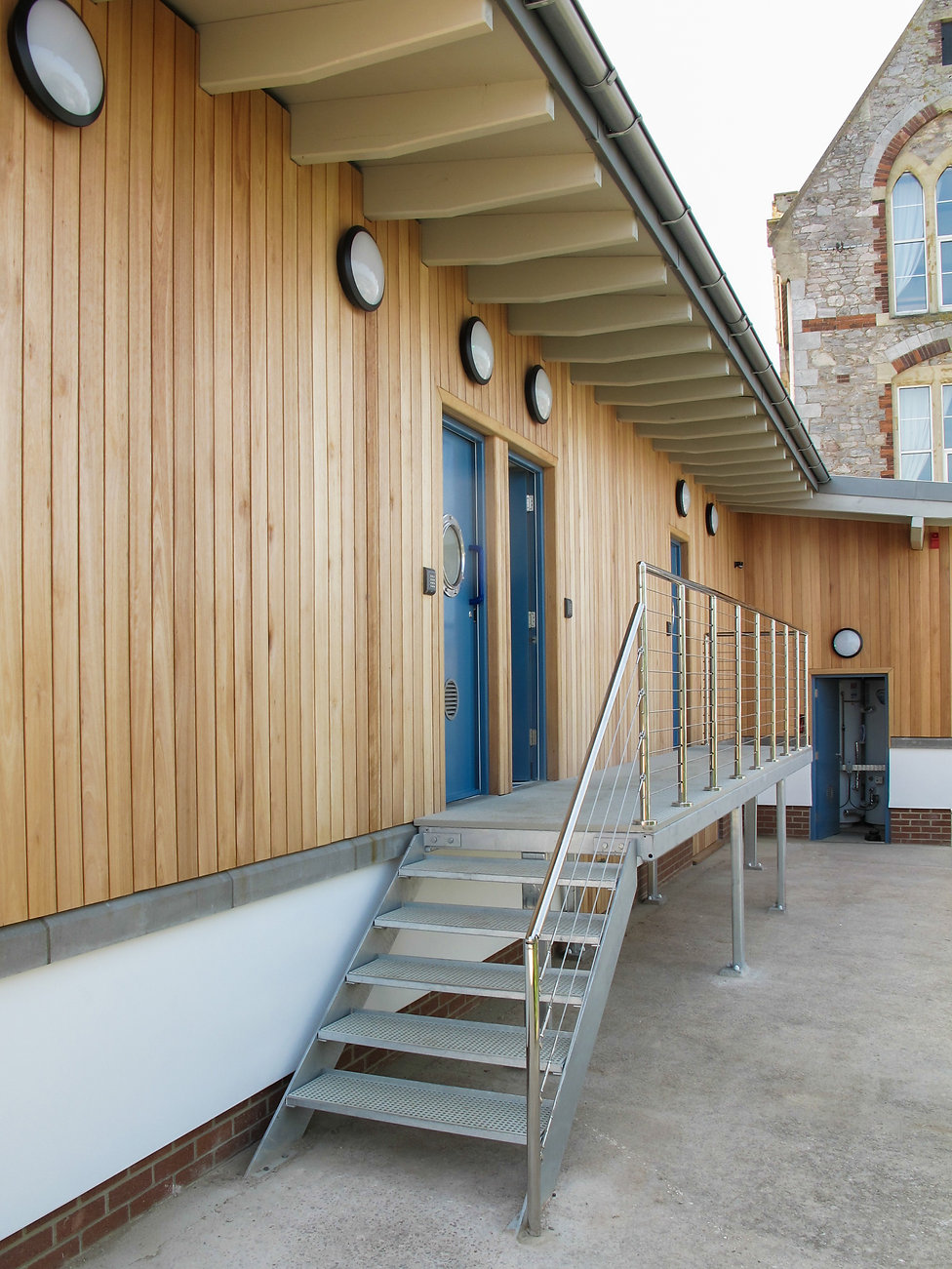 Vertical Timber Cladding with Stainless Steel Post and Wire Balustrading